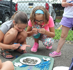 Children participating in outdoor craft