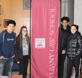 Students near Albany Law School banner